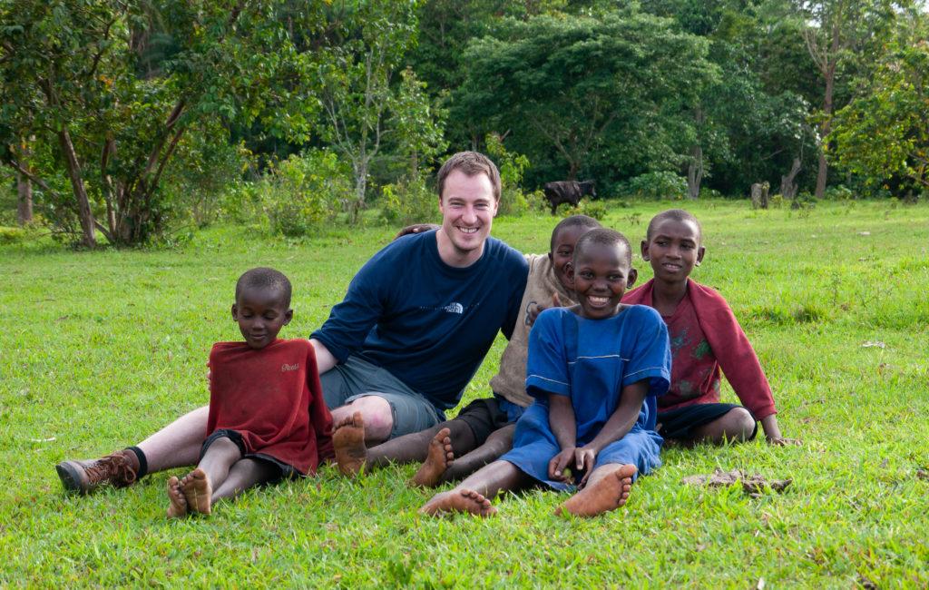Responsible travel. Playing with children near Bigodi, Uganda