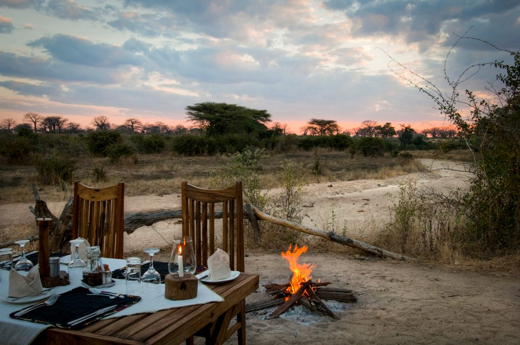 Outdoor dining at Kigelia Camp in Ruaha, Tanzania